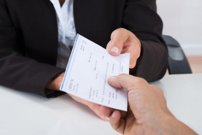 Une solution pour se protéger de l'arnaque au chèque de banque. © Shutterstock