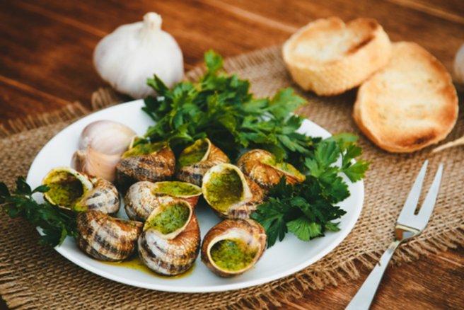 Les escargots à la bourguignonne sont un plat très apprécié des Français pour les fêtes de fin d'année. © Shutterstock