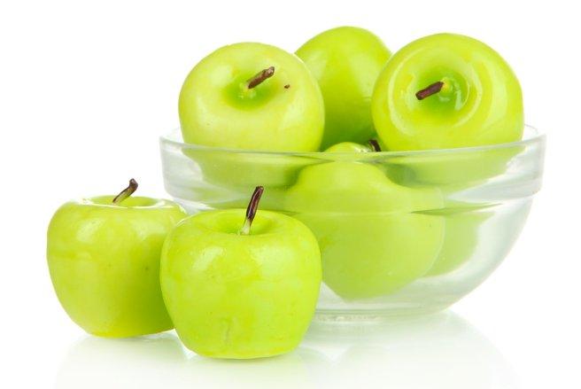 Ces objets ressemblent à des pommes, et pourtant, ce sont des bougies. © Shutterstock